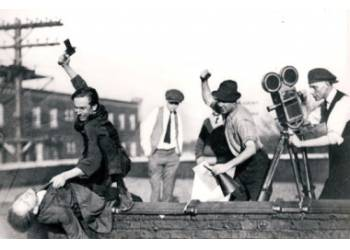 "Walt is ""attacking"" Maxwell; Ub Iwerks is holding the director's megaphone, and Adolph Kloepper is behind the camera"